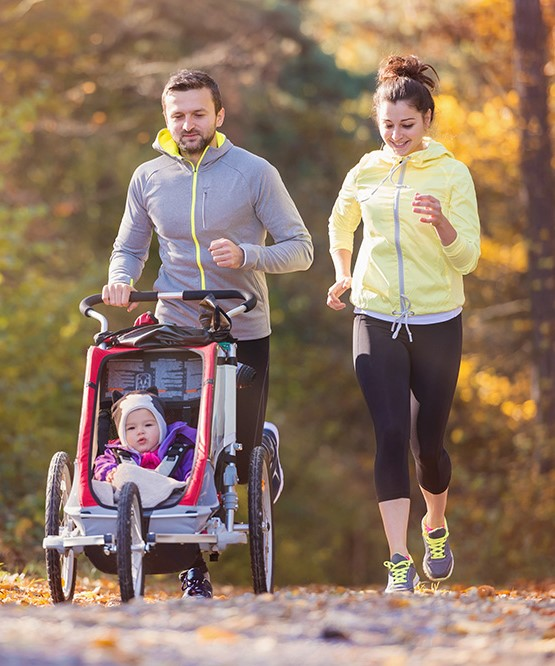 A Couple Jogging With a Small Child - Mortgage Lender Gerard Buckely of Jaguar Mortgages for Wasaga Beach, Collingwood, & Thornbury.