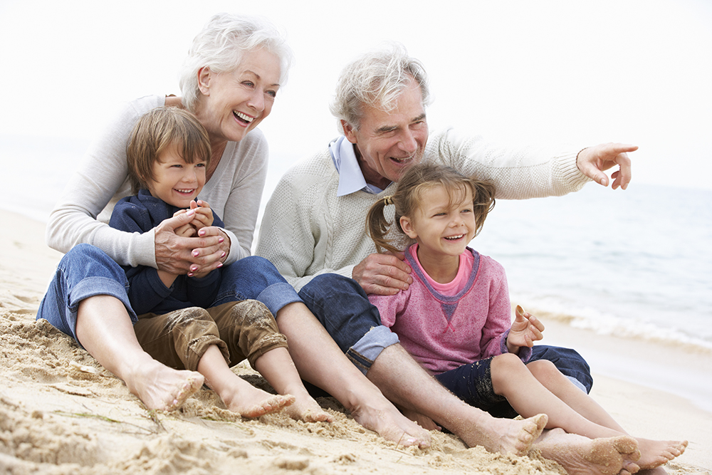 Grandparents With Their Grandchildren on the Beach - Mortgage Lender Gerard Buckely of Jaguar Mortgages for Wasaga Beach, Collingwood, & Thornbury.