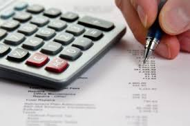 A Person Calculating Expenses - Mortgage Lender Gerard Buckely of Jaguar Mortgages for Wasaga Beach, Collingwood, & Thornbury.